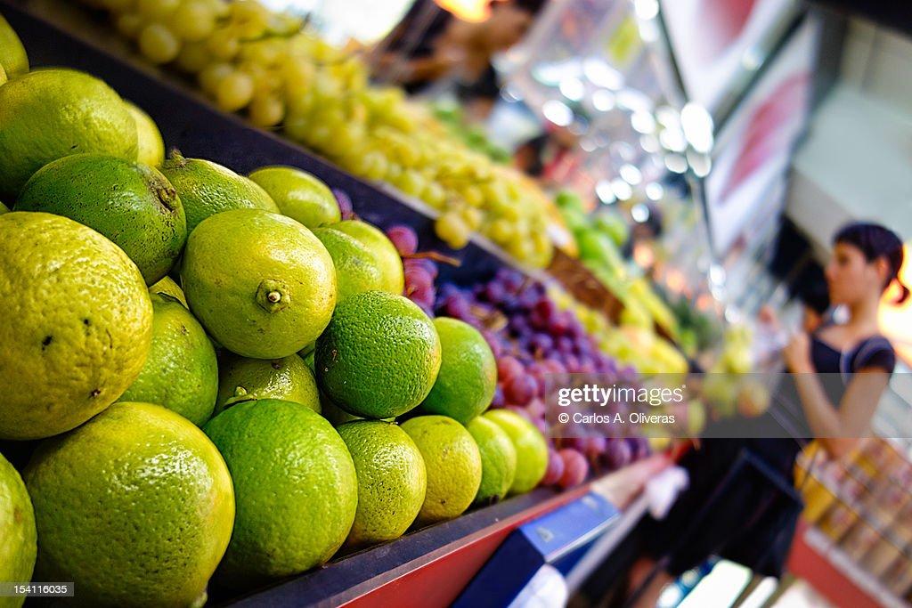 Girl buying fruit : Stock Photo