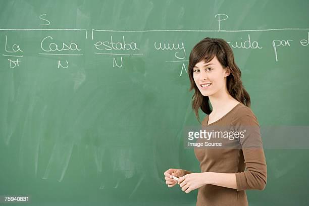 Girl by blackboard
