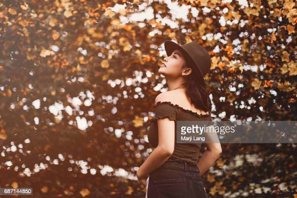 Girl by the flannelbush trees in bloom during spring season Santa Clara California USA
