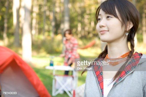Girl camping with friend : Stock Photo