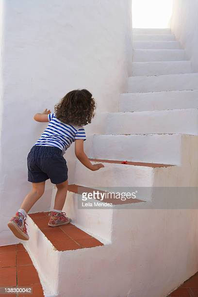 Girl carefully climbing steps