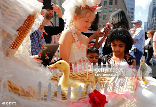 A girl carries Ducks on a stroller in front of St Patrick's Cathedral as she attends the annual Easter Parade and Easter Bonnet Festival on the Fith...