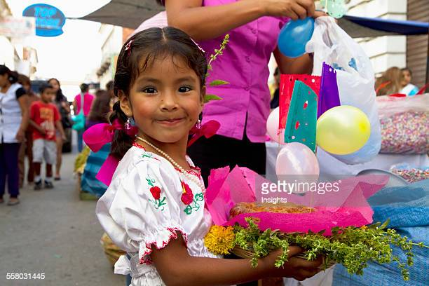 Girl Carrying A Gift Basket At The Jueves De Comadres Market During Carnaval Chapaco Tarija Bolivia