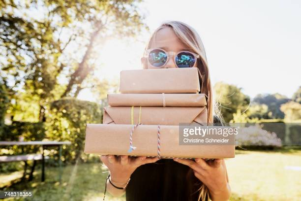 Girl carrying brown paper packages