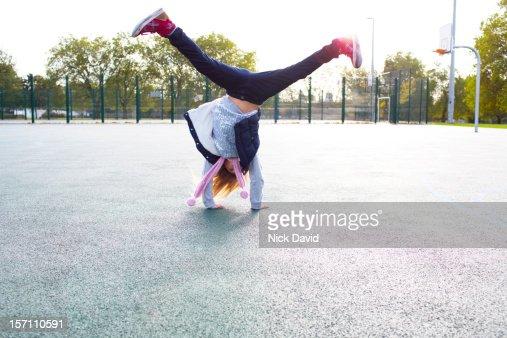 girl cartwheeling : Stock Photo