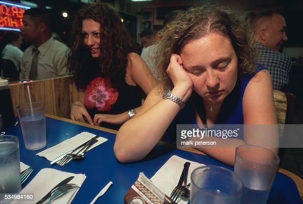 A girl catches a little sleep while waiting for her food at Bob and Edith's Diner a 24hour diner in Arlington Virginia