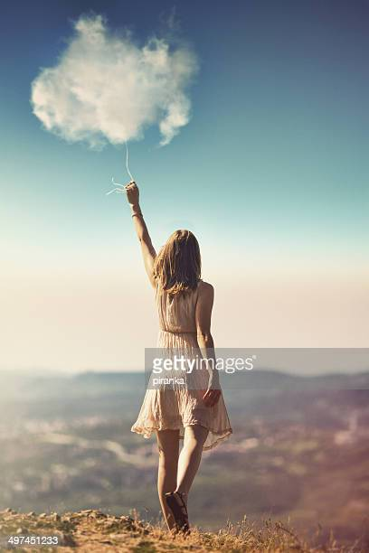 Girl catching clouds