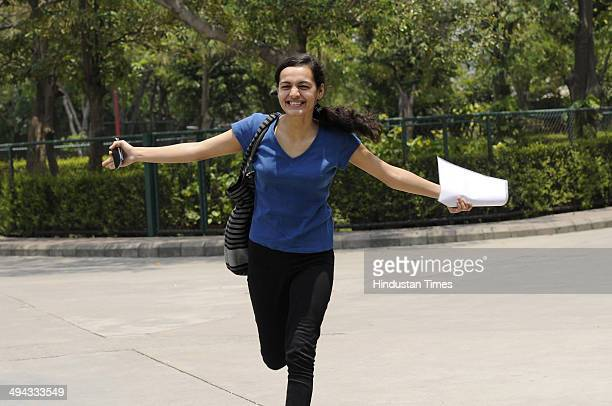 A girl celebrates after her class XII board exams result is declared by Central Board of secondary Education on May 29 2014 in Noida India Girls have...