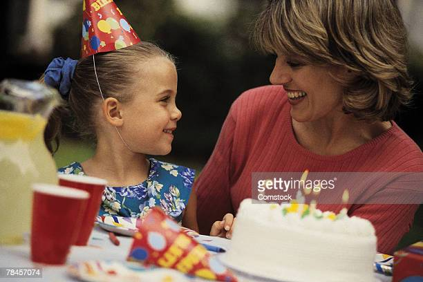 Girl celebrating birthday with mother