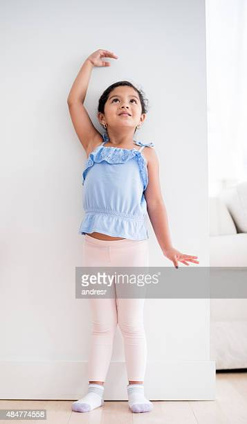 Girl checking how tall she's grown