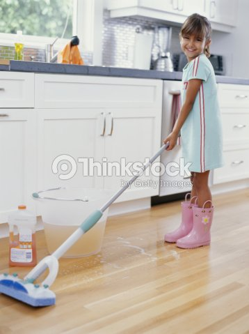 Girl Cleaning Kitchen Floor With Mop Smiling Portrait Stock Photo ...