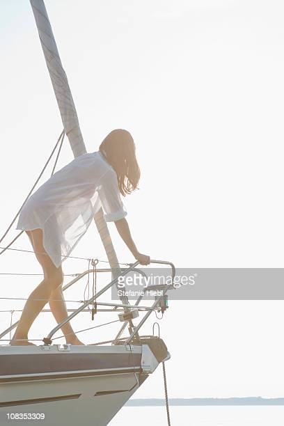 Girl climbing on front of boat