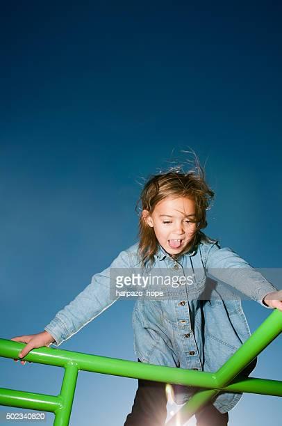 Girl Climbing on Playground Equipment
