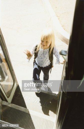 Girl Climbing onto Bus : Stock Photo