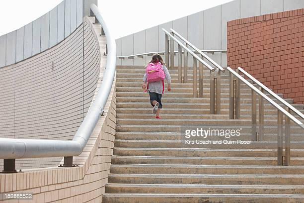 Girl climbing steps outdoors