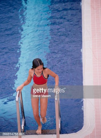 Girl Climbing Up Pool Steps Out Of Swimmingpool Elevated View Stock Photo Getty Images