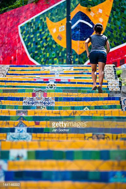 A girl climbs the Selaron's Stairs a mosaic staircase made of colorful tiles on February 12 2012 in Rio de Janeiro Brazil World famous staircase...