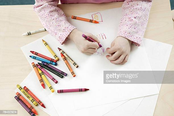 Girl coloring with crayons
