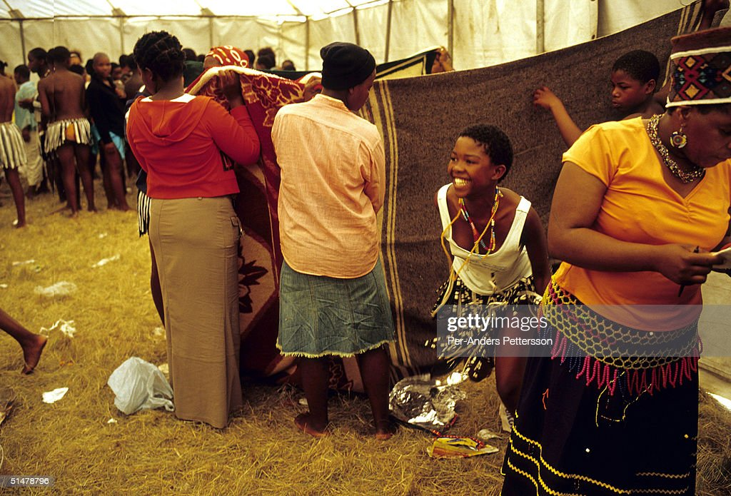 A girl comes out smiling after being tested for her virginity during the annual Reed Dance on September 11, 2004 in Nongoma in rural Natal, South Africa. About 20,000 maidens from all over South Africa arrived to dance for Zulu King Goodwill Zwelethini at the Enyokeni Royal Palace in Kwa-Nongoma about 350 kilometers from Durban. The girls come to the kingdom to declare their virginity and the ceremony encourages girls and young women to abstain from sexual activity to curb the spread of HIV/AIDS.