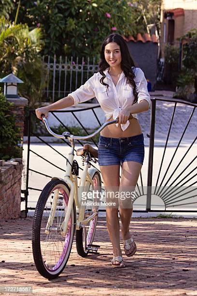 Girl coming home with bike