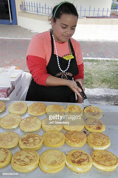 A girl cooking arepas at the Calle Ocho Street Festival