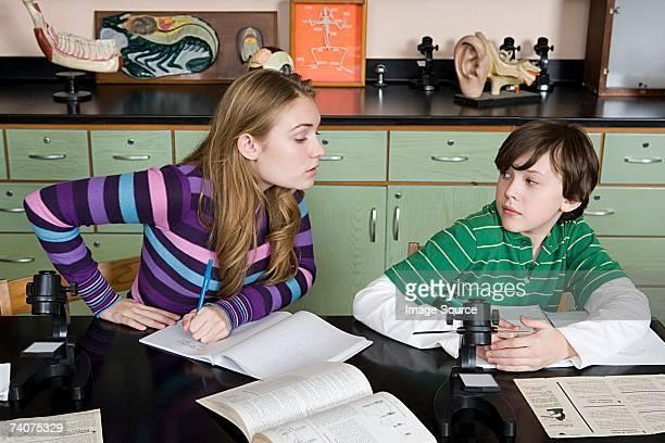 Girl copying boy in class