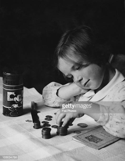 A girl counting her savings 20th September 1941 She is planning invest the money in the British government's National Savings scheme