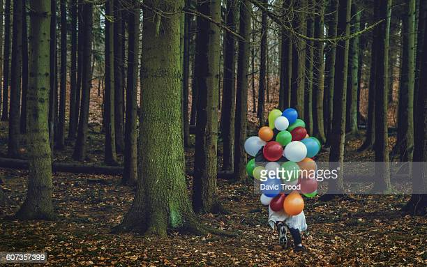 Girl covered with balloons