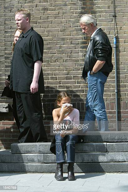 A girl cries after paying her respects to slain politician Pim Fortuyn May 9 2002 at a cathedral in Rotterdam Netherlands Thousands of people lined...