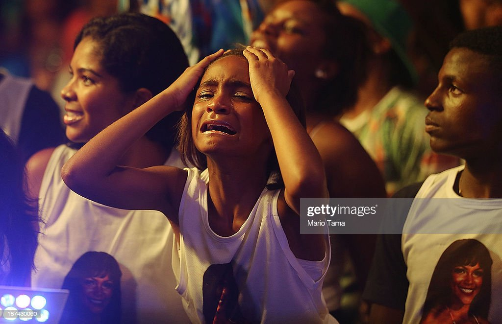 A girl cries after the contestant she was supporting for queen lost at the ceremony deciding Rio's 2014 Carnival Queen and King in the port district on November 8, 2013 in Rio de Janeiro, Brazil. Rio's Carnival runs February 28 through March 4, just three months before the start of the 2014 FIFA World Cup in June.