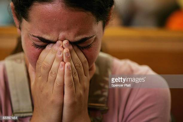 A girl cries at the synagogue in the Israeli settlement of Neve Dekalim in the Gush Katif block of Settlements on August 17 2005 in Gaza Strip...