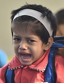 A girl cries on the first day of school at Mira Road on June 15 2016 in Mumbai India Attired in brandnew uniforms the children turned up at their...