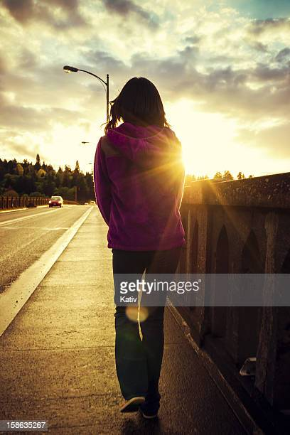 Girl crossing a bridge