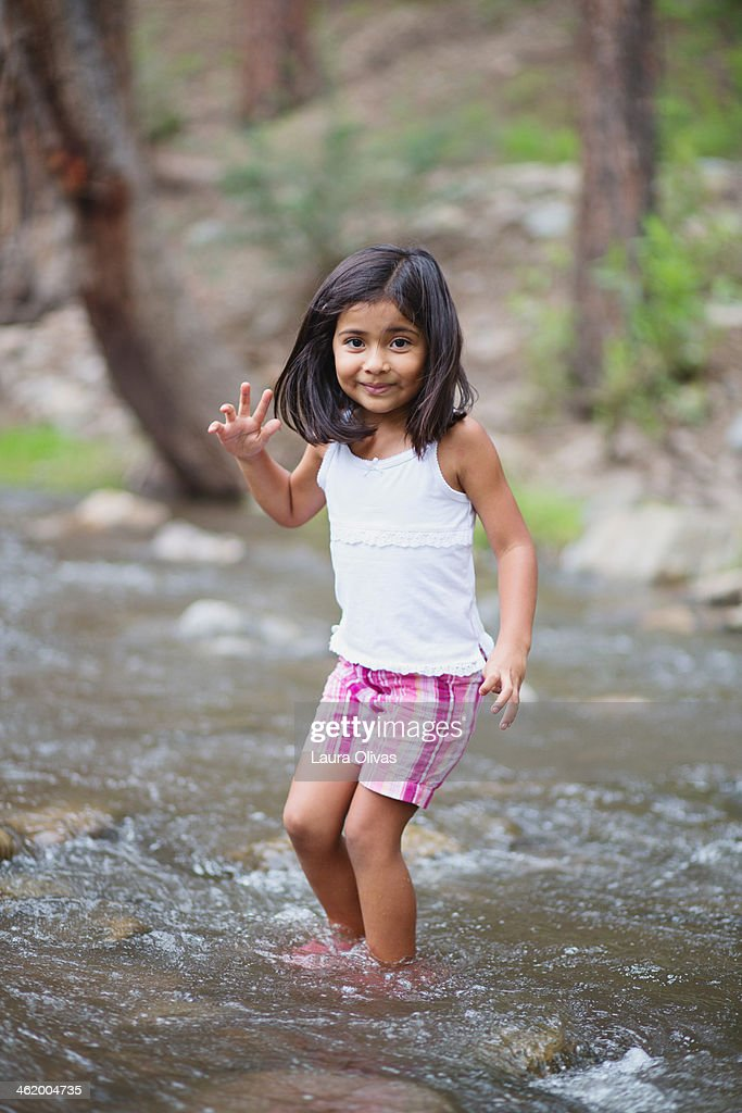 Girl Crossing a Stream : Stock Photo