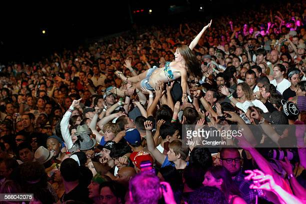 INDIO CA–– APRIL 19 2009––A girl crowd surfs during the Public Enemy show at the 10th annual Coachella Music and Arts Festival at the Empire Polo...
