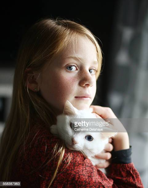 A girl cuddling her cat