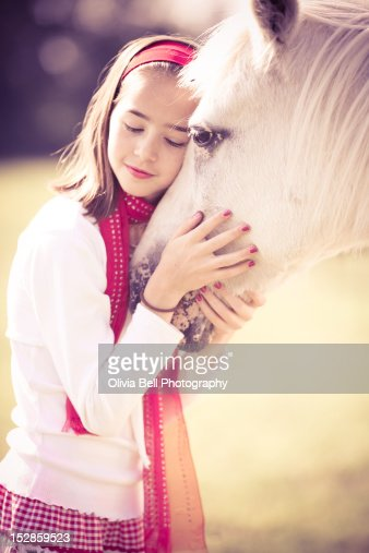 Girl Cuddling White Horse Stock Photo Getty Images