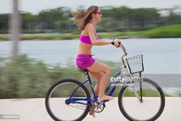 Girl cycling barefoot