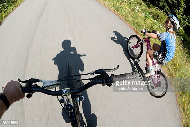 Girl cycling down a road