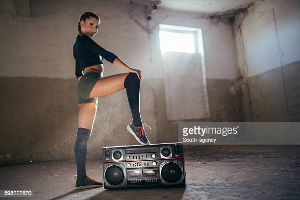 Girl dancer by radio
