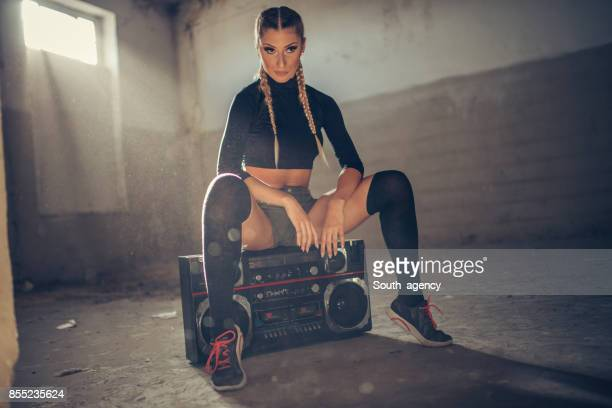 Girl dancer sitting on radio