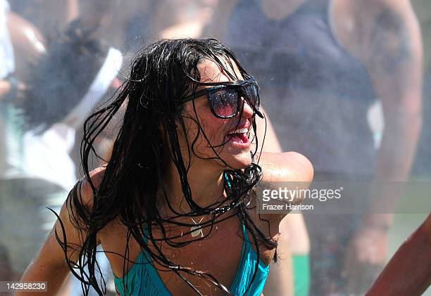 A girl dances in the water during Day 3 of the 2012 Coachella Valley Music Arts Festival held at the Empire Polo Club on April 15 2012 in Indio...