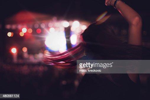 Girl dancing at concert : Stock Photo