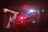 Girl dancing at concert