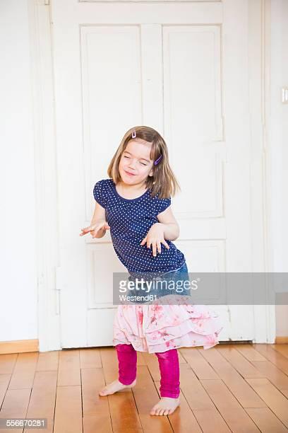 Girl dancing at wooden door