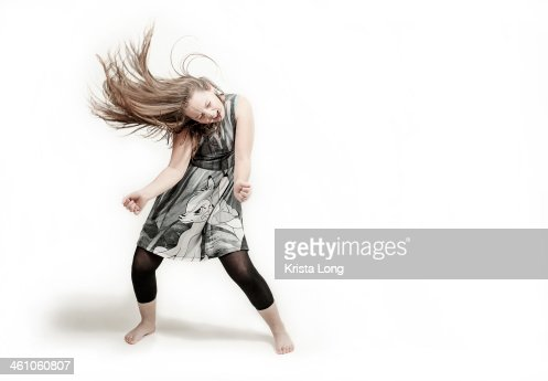 girl dancing on a plain white background