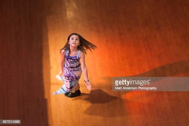 Girl dancing on Dance Floor Looking Up