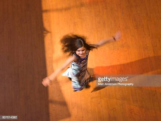 Girl dancing on Dance Floor Spinning