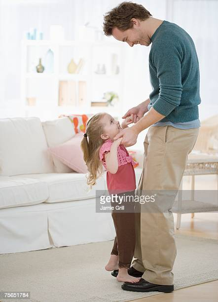 Girl dancing on father's feet