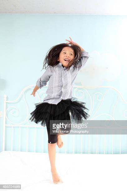Girl dancing on her bed